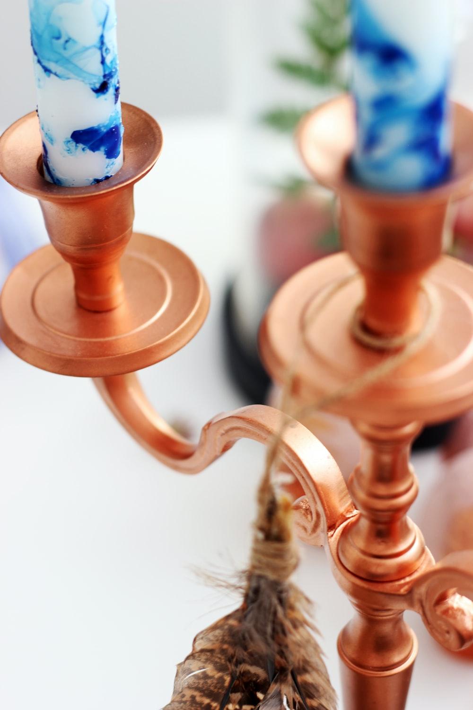 closeup photo of brass-colored candelabra