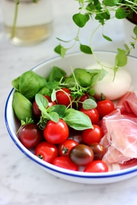 red tomato on bowl