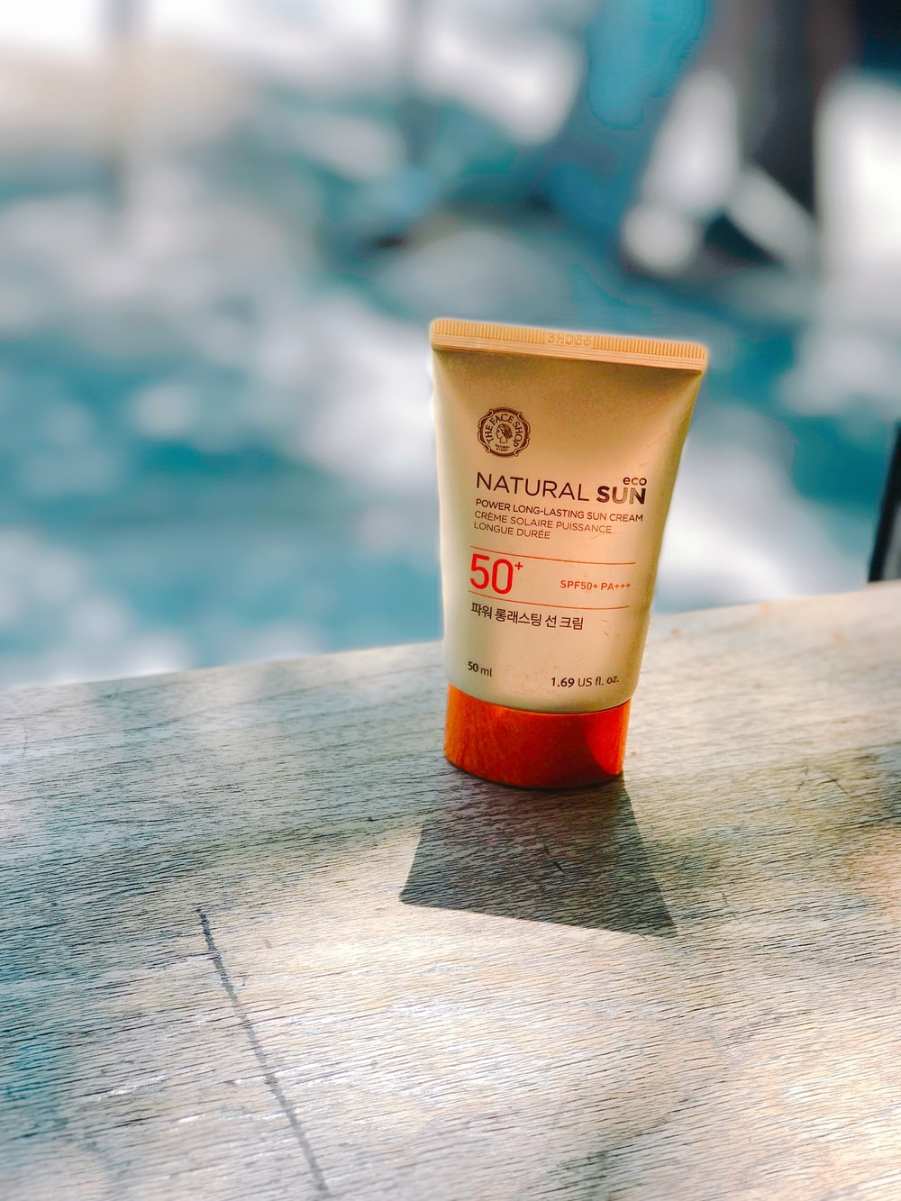 Natural Sun cream bottle on table