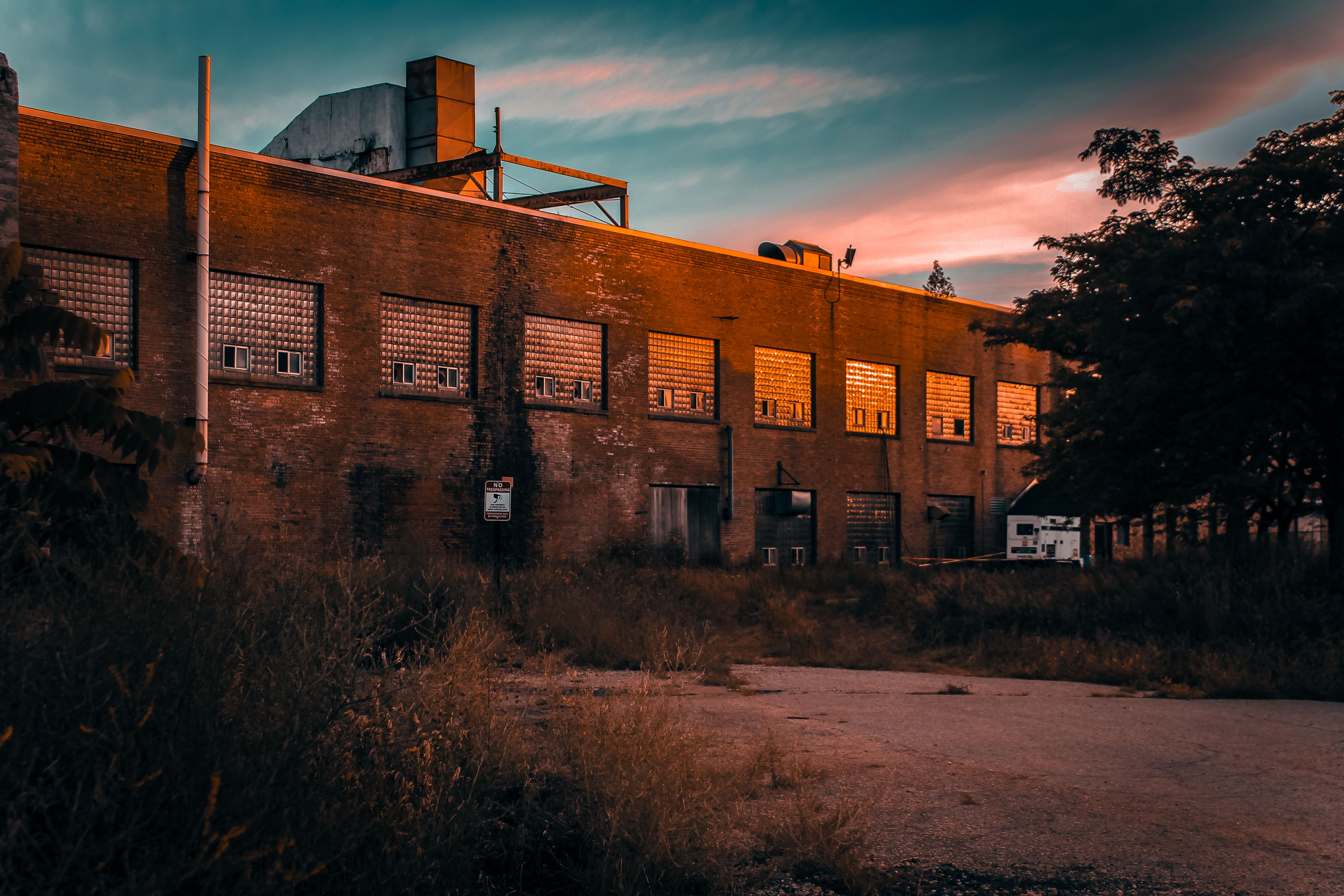 architectural photography of brown brick industrial building