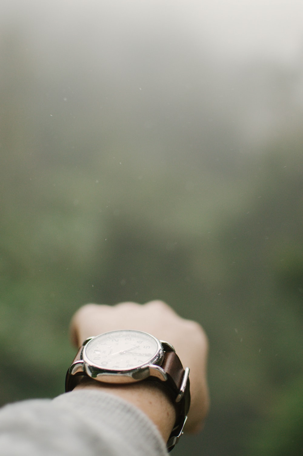 selective-focus photography of person wearing watch