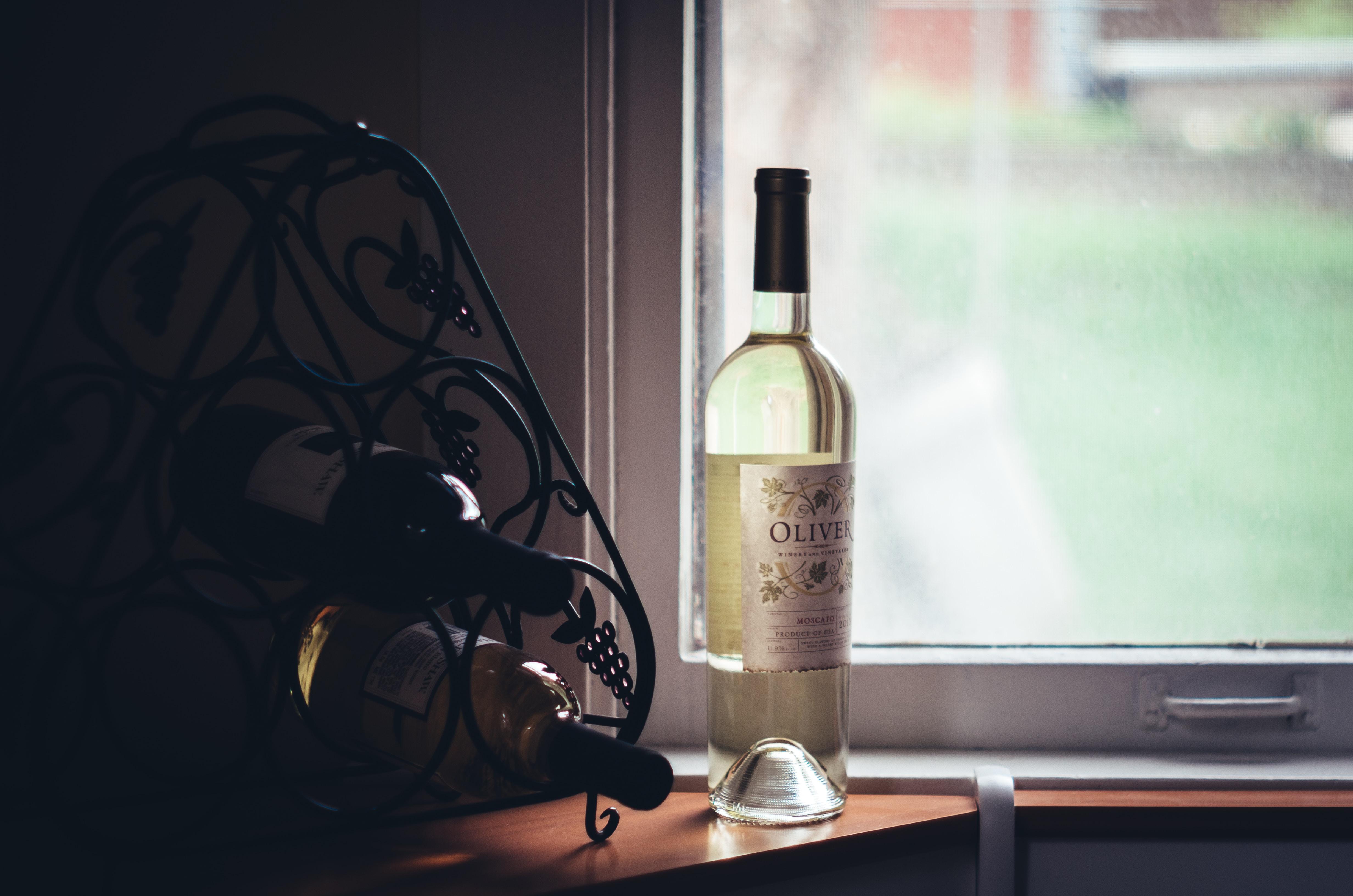 clear glass bottle near window