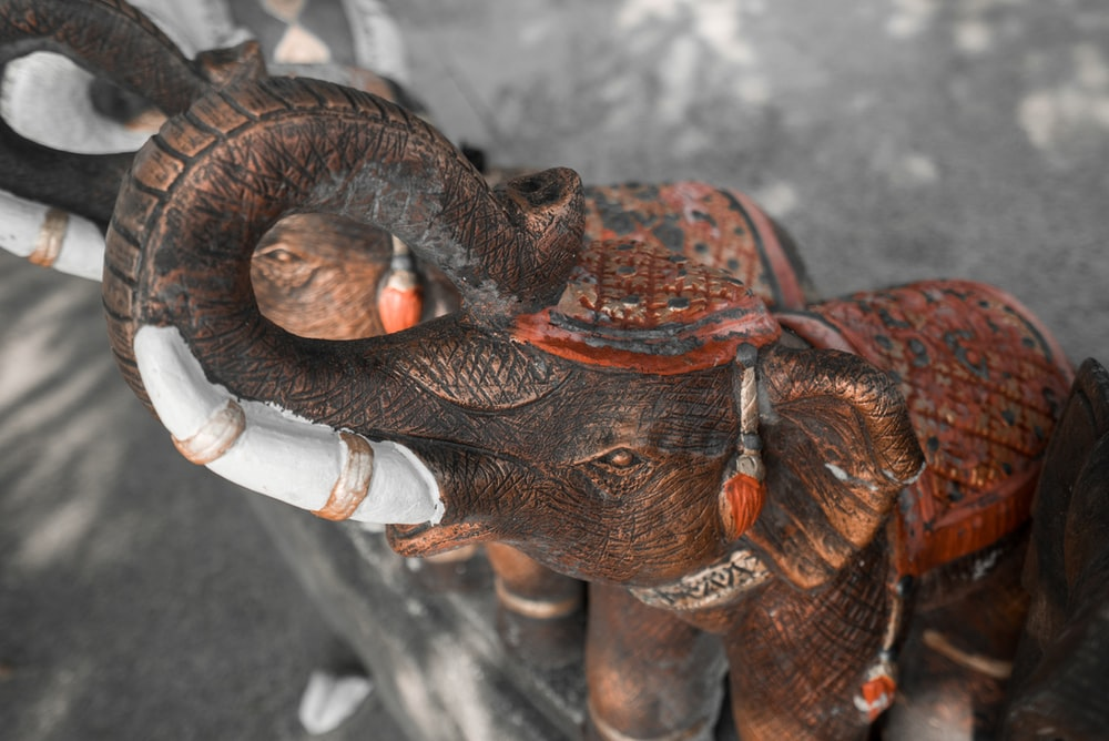 two brown elephant ceramic figurines