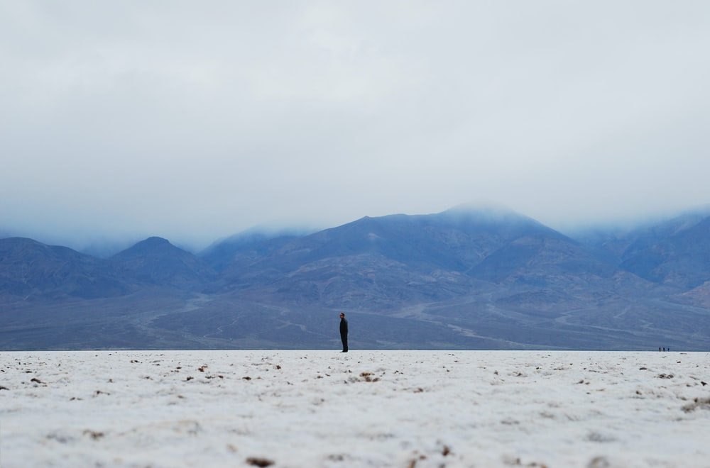 photo of person standing on white field