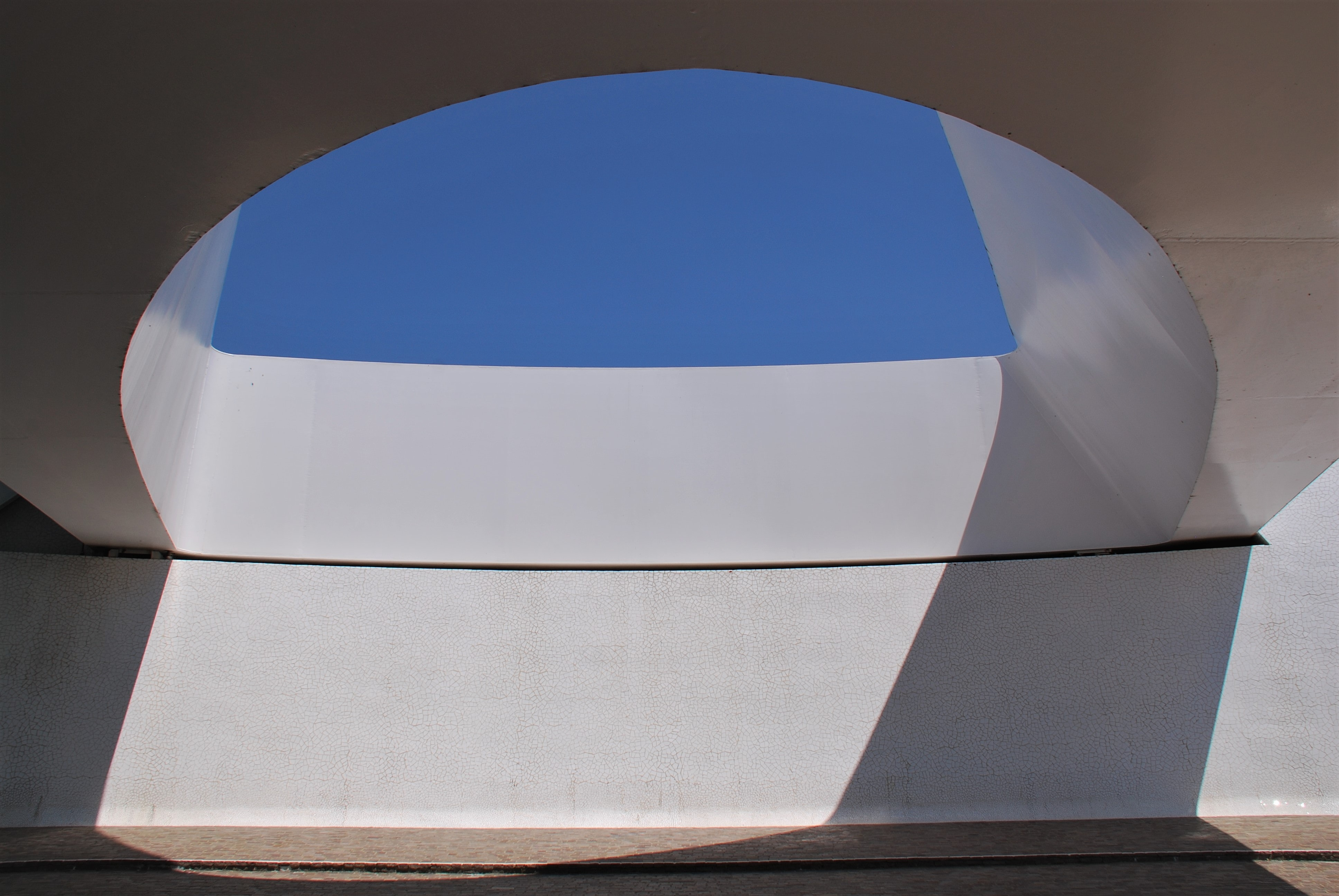 low angle photography of white concrete building hole