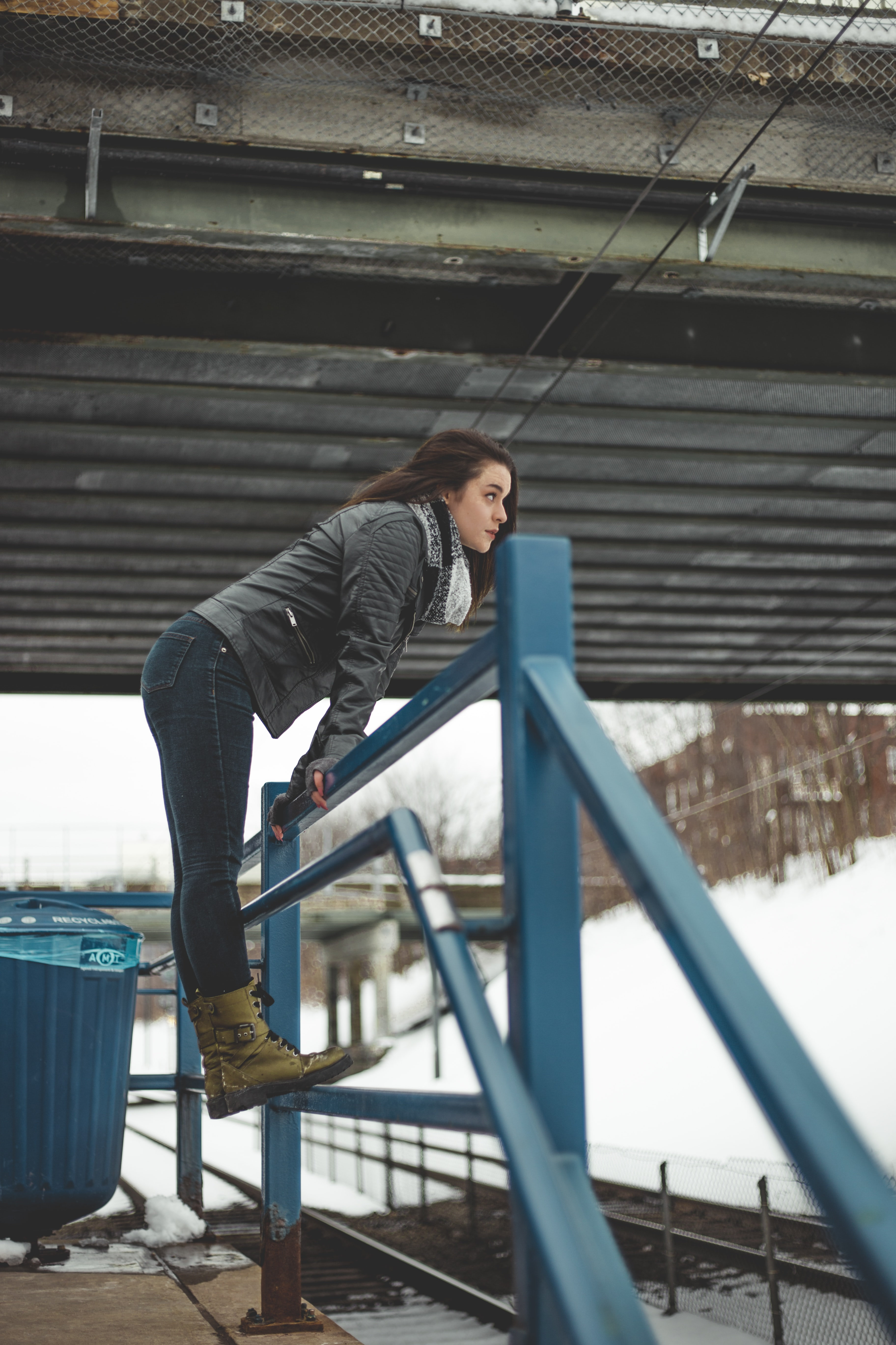 woman standing on blue rails