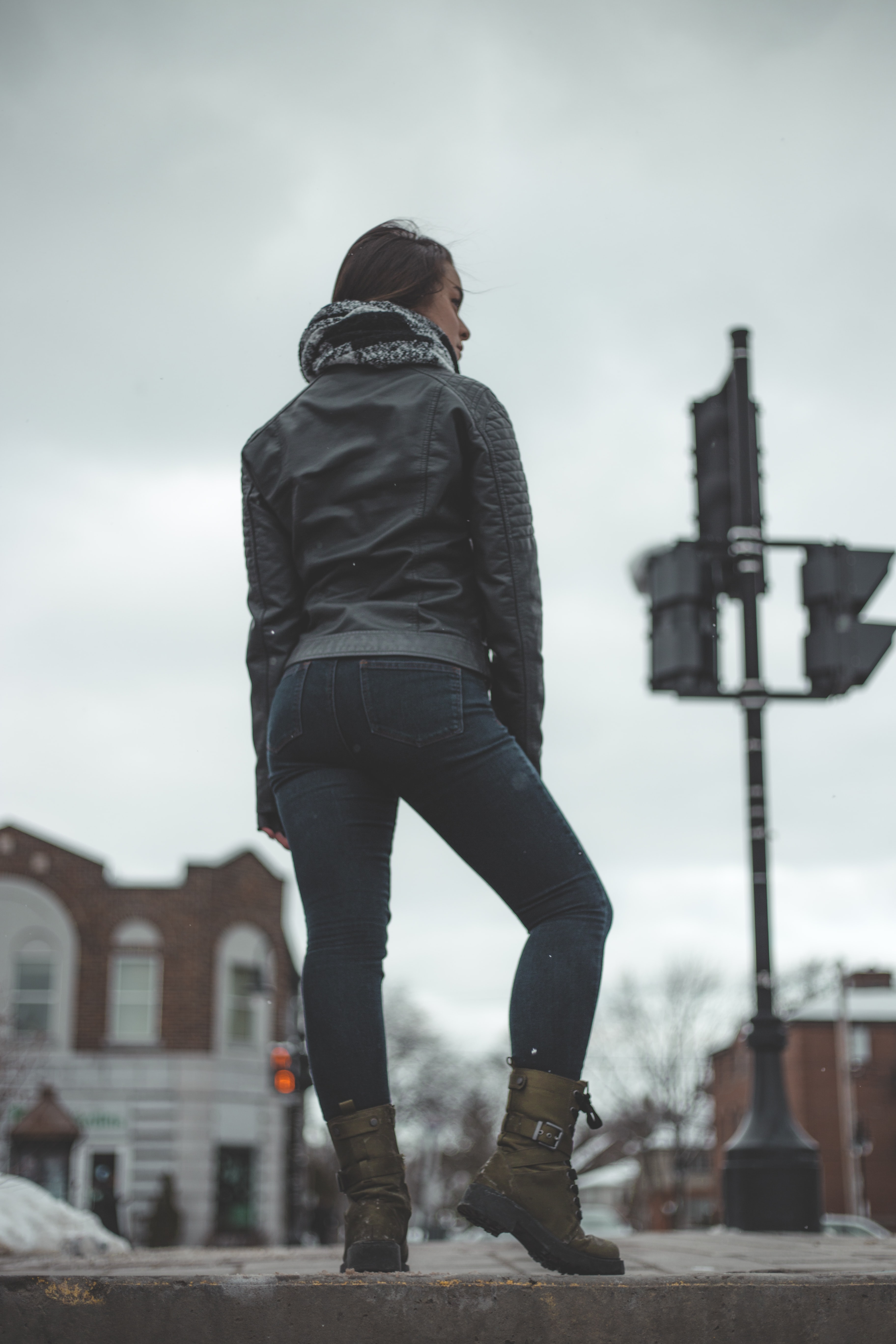 selective focus photo of woman standing on roadway