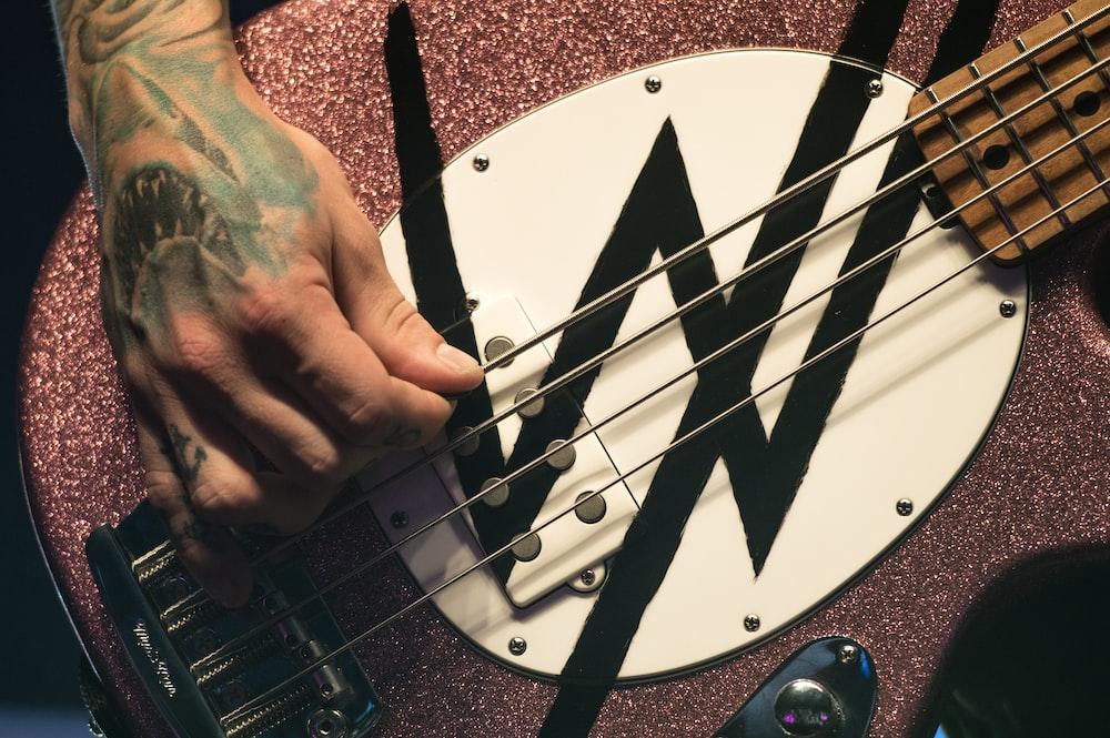 man playing 4-string bass guitar