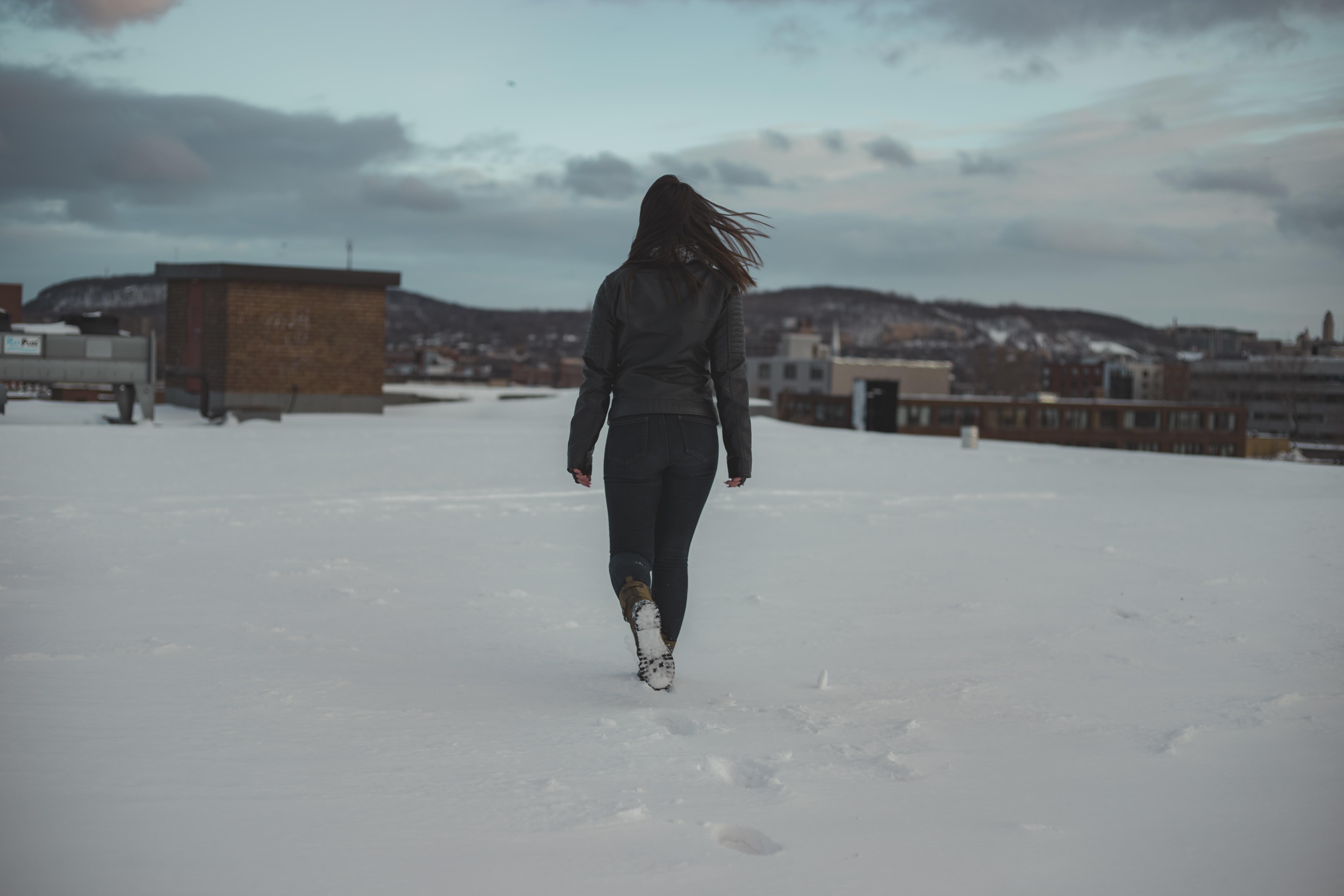 woman walking through brown building
