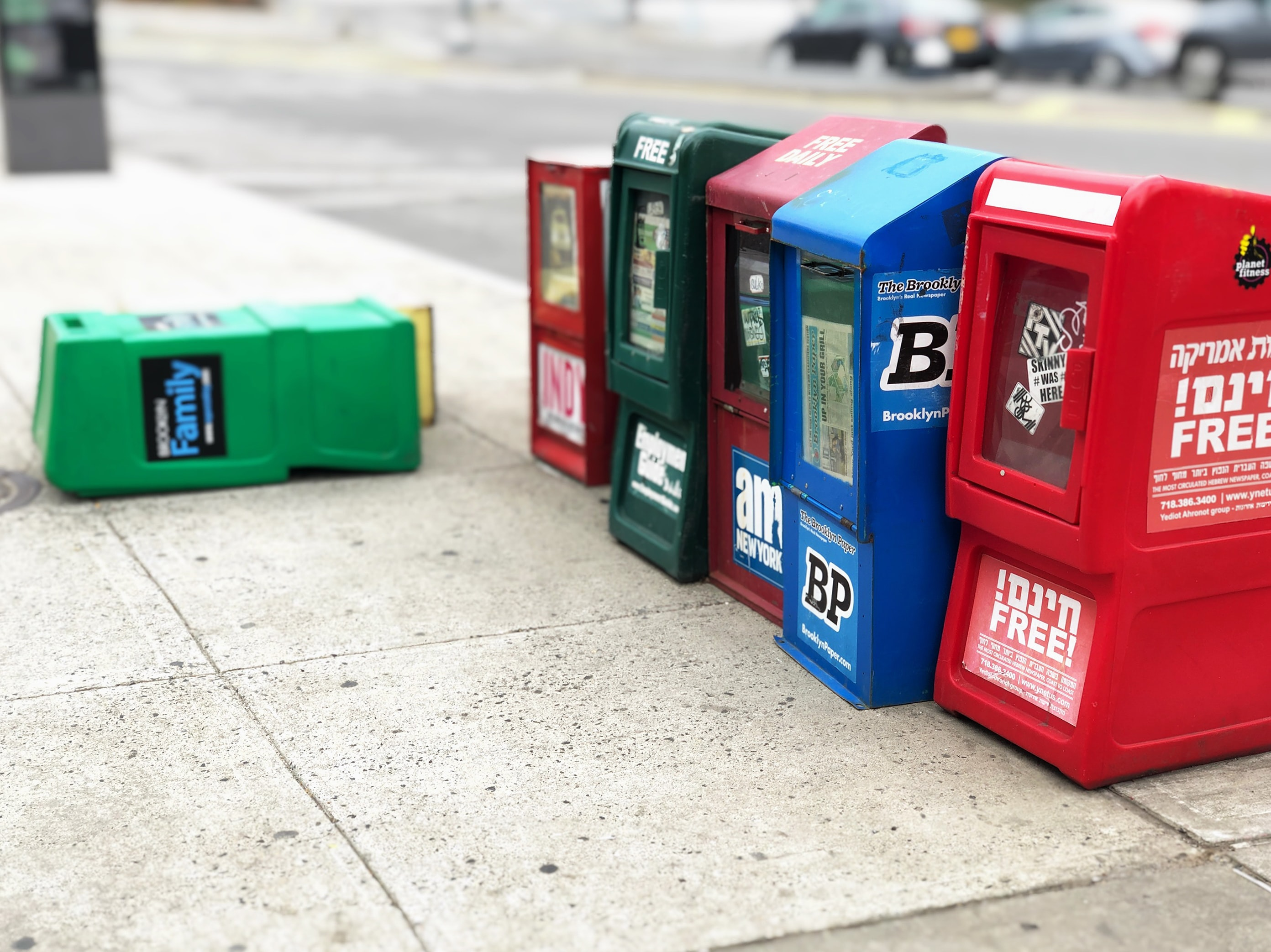 assorted-color mail boxes beside street