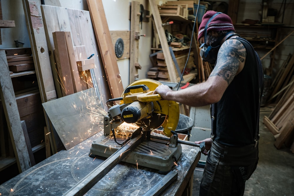 man using cut off saw