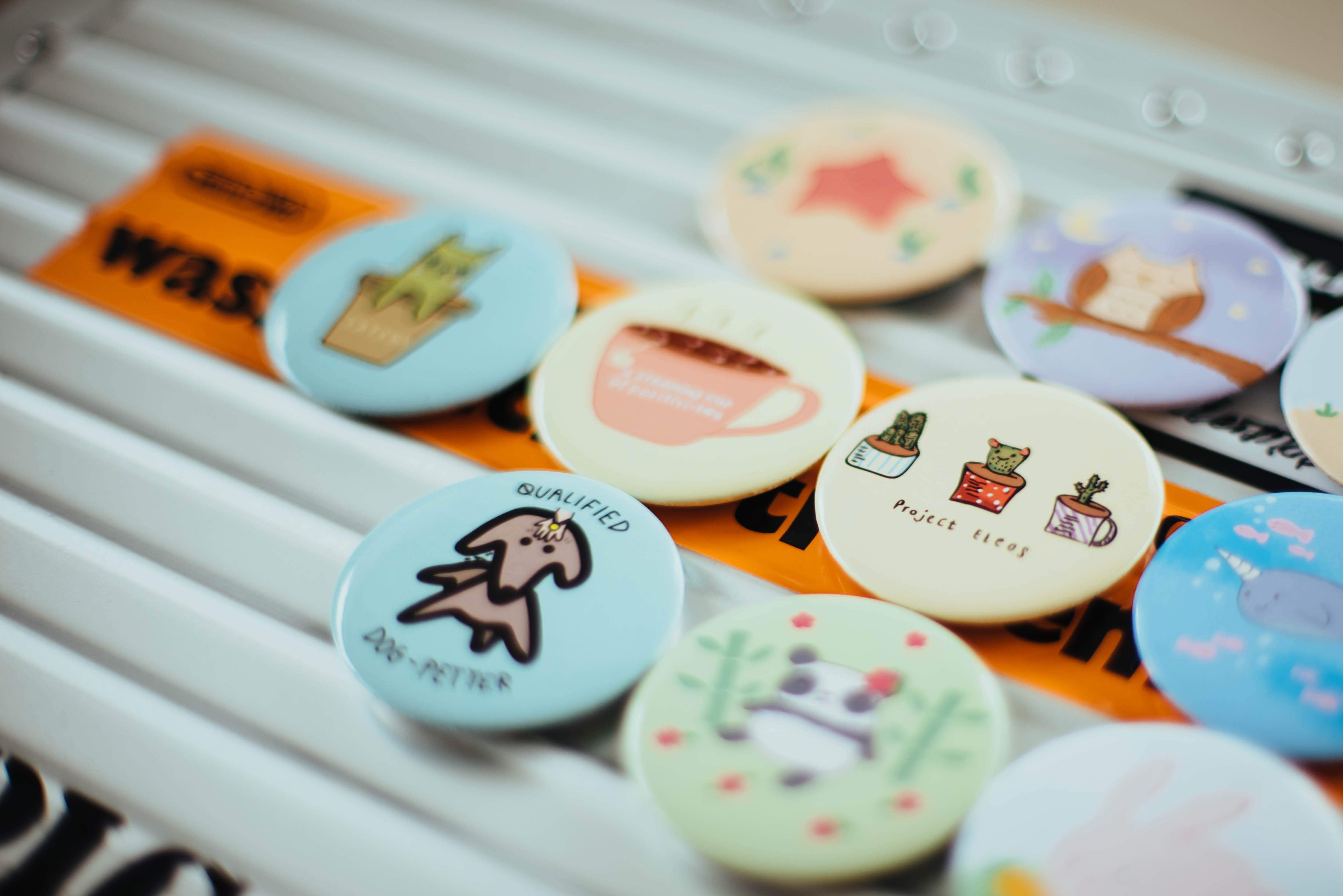 assorted-color button pins on top of white surface