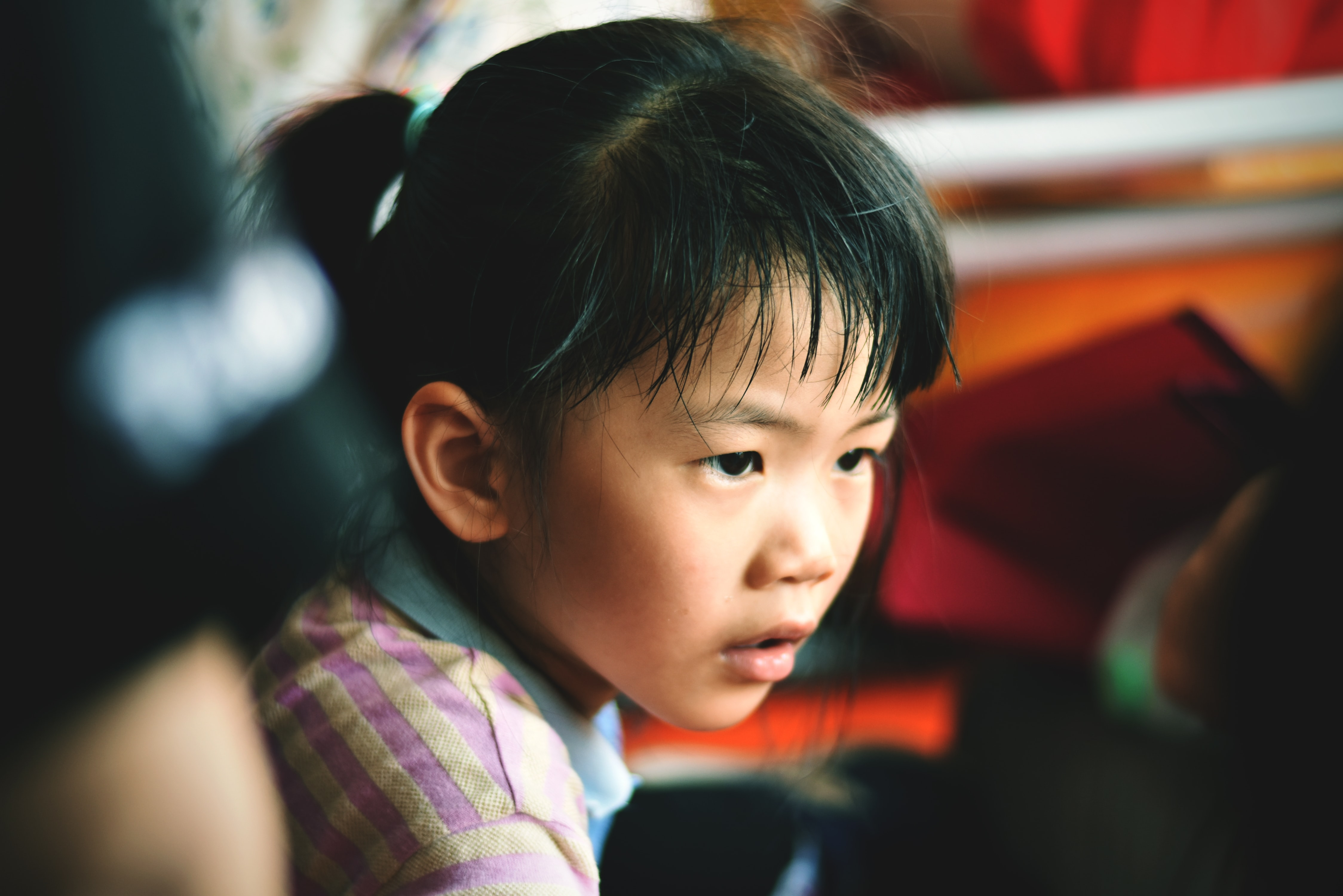 selective focus photography of girl wearing striped collared top