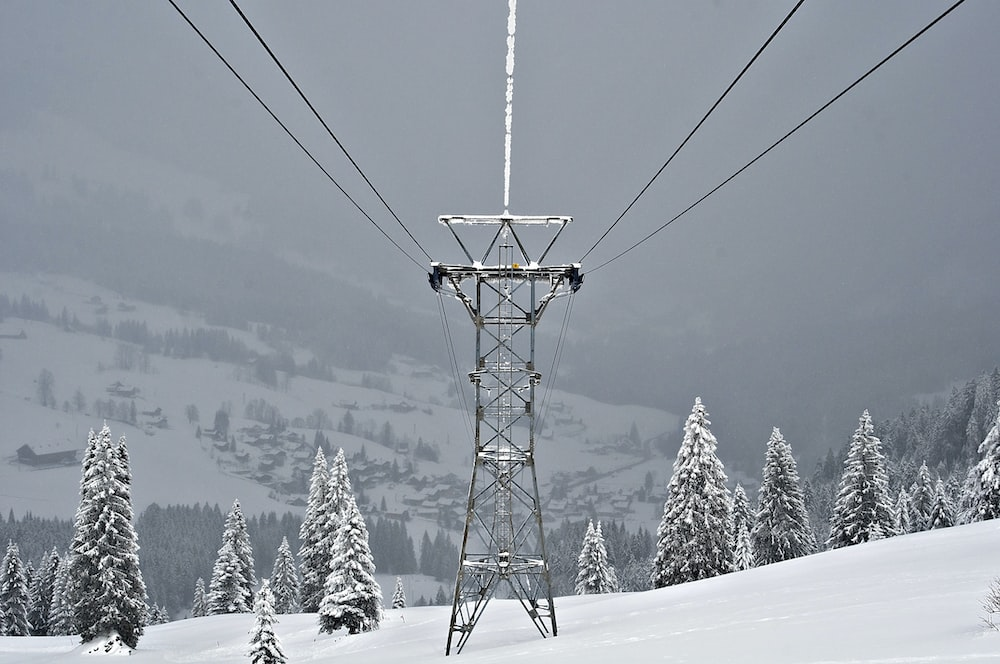 black metal transmission line covered with snow