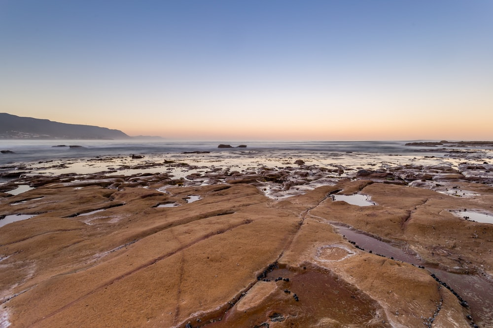 landscape photo of land near body of water