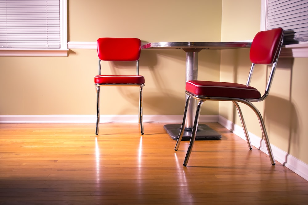 red and gray chair beside table