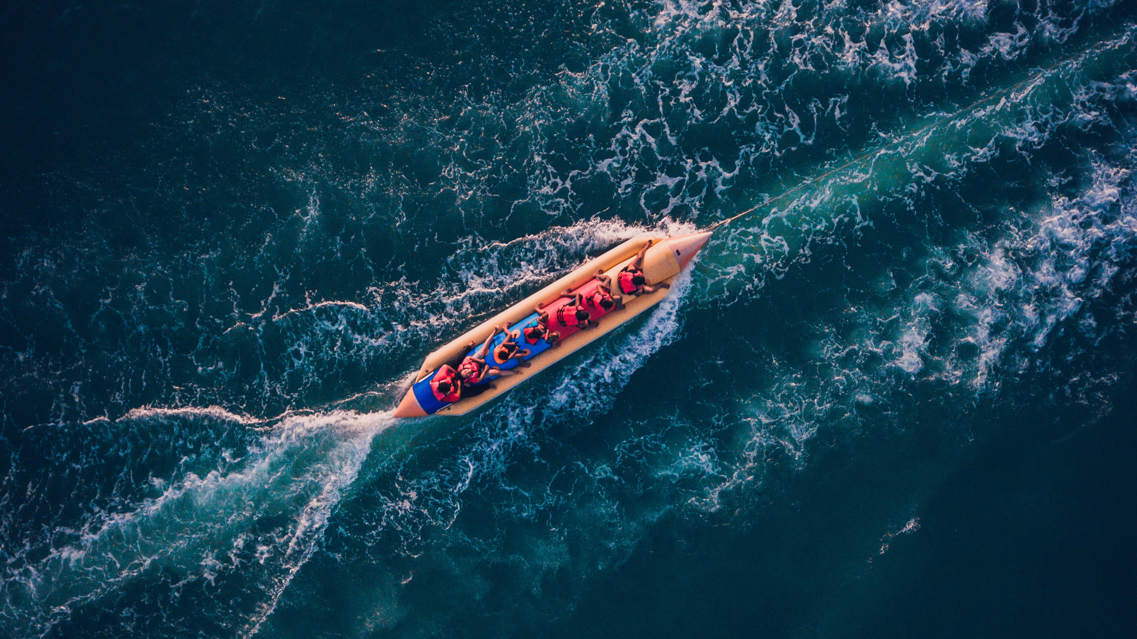 bird's eye view photography of boat on body of water