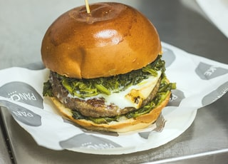 hamburger with vegetables on plate