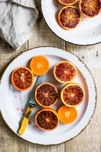 sliced oranges on white plate