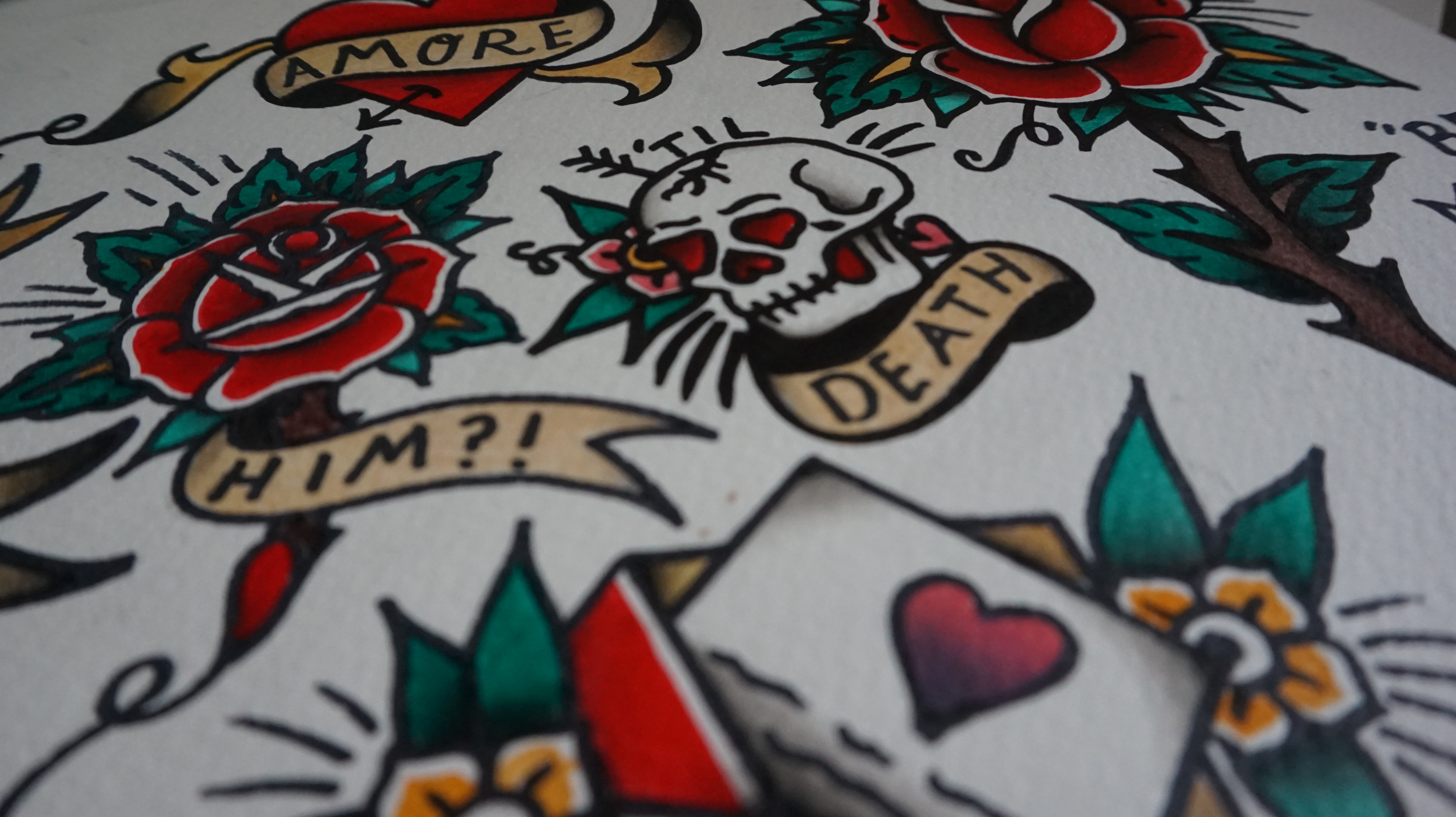 white, green, and red skull and flower print textile
