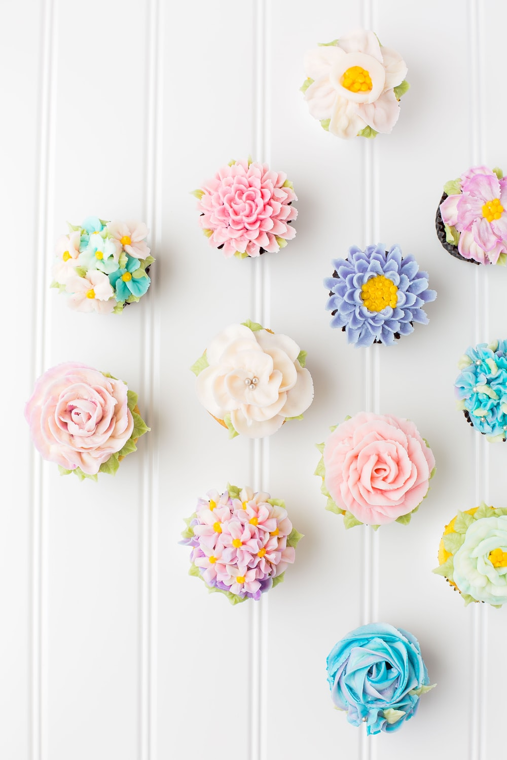flower cupcakes on white surface