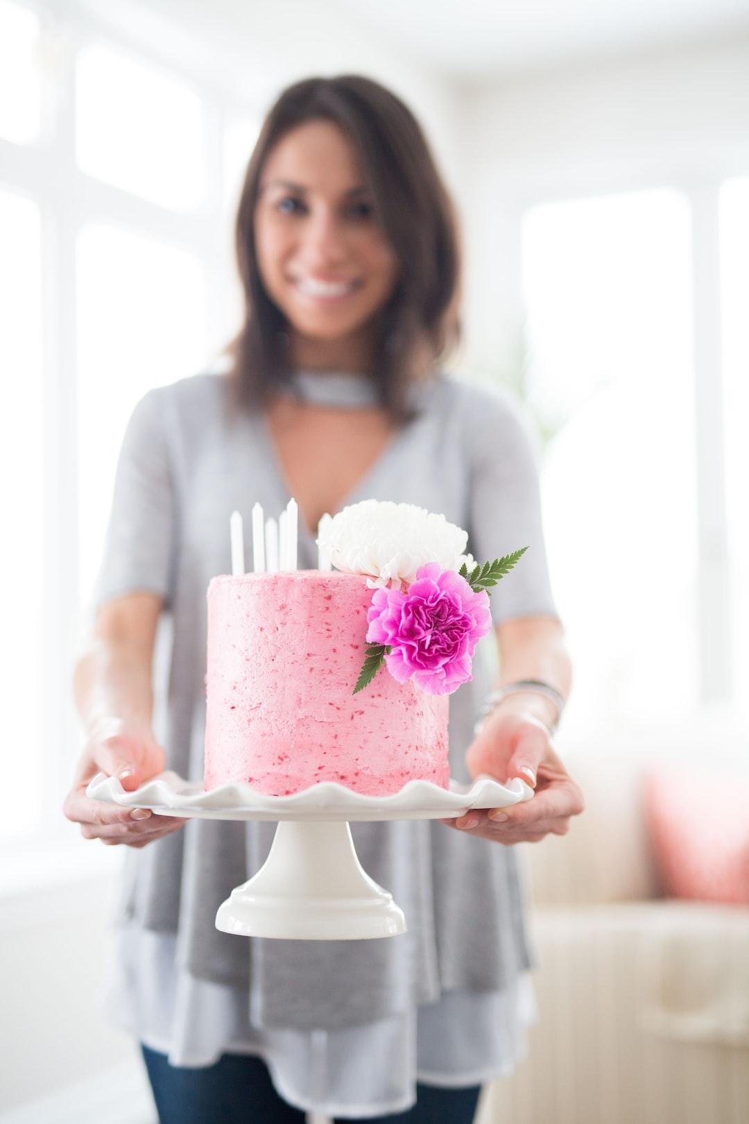 Holding the birthday cake