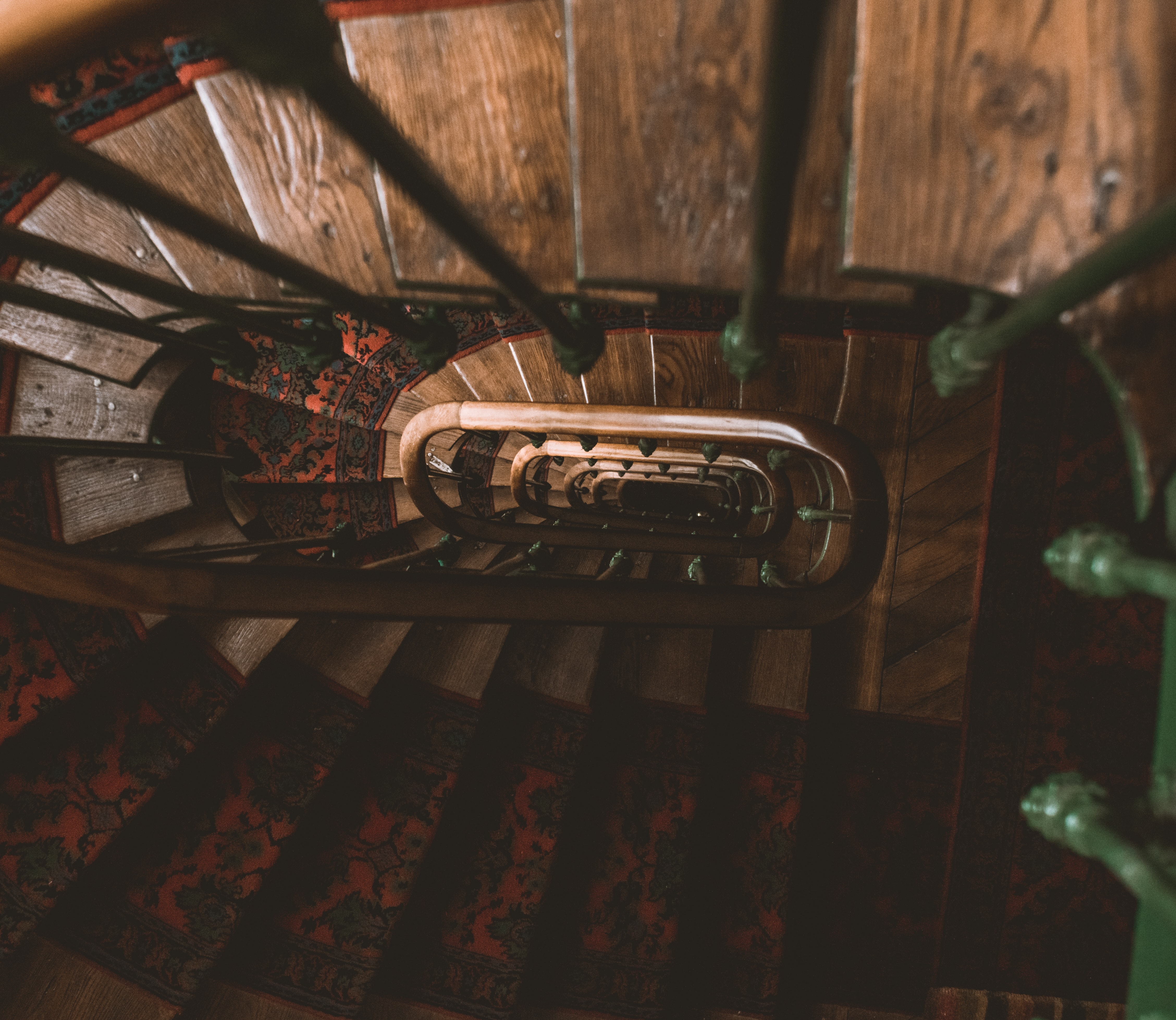 brown and green metal handrails