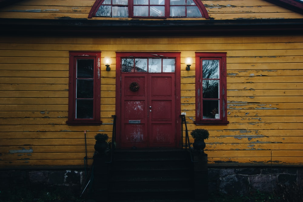 photo of brown painted house