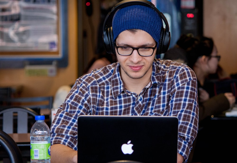 man using MacBook during daytime