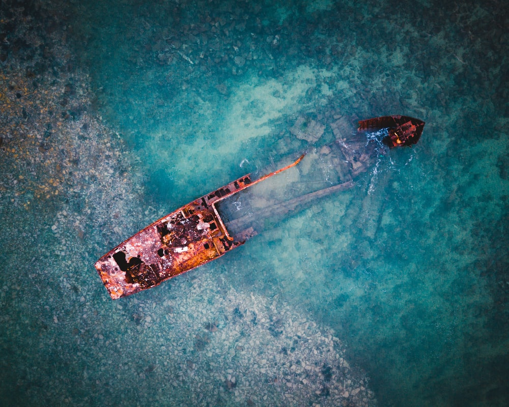 aerial view of brown ship on body of water