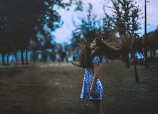 woman standing outside of plain field