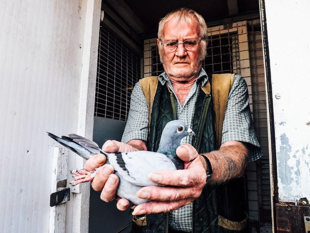 man holding pigeon