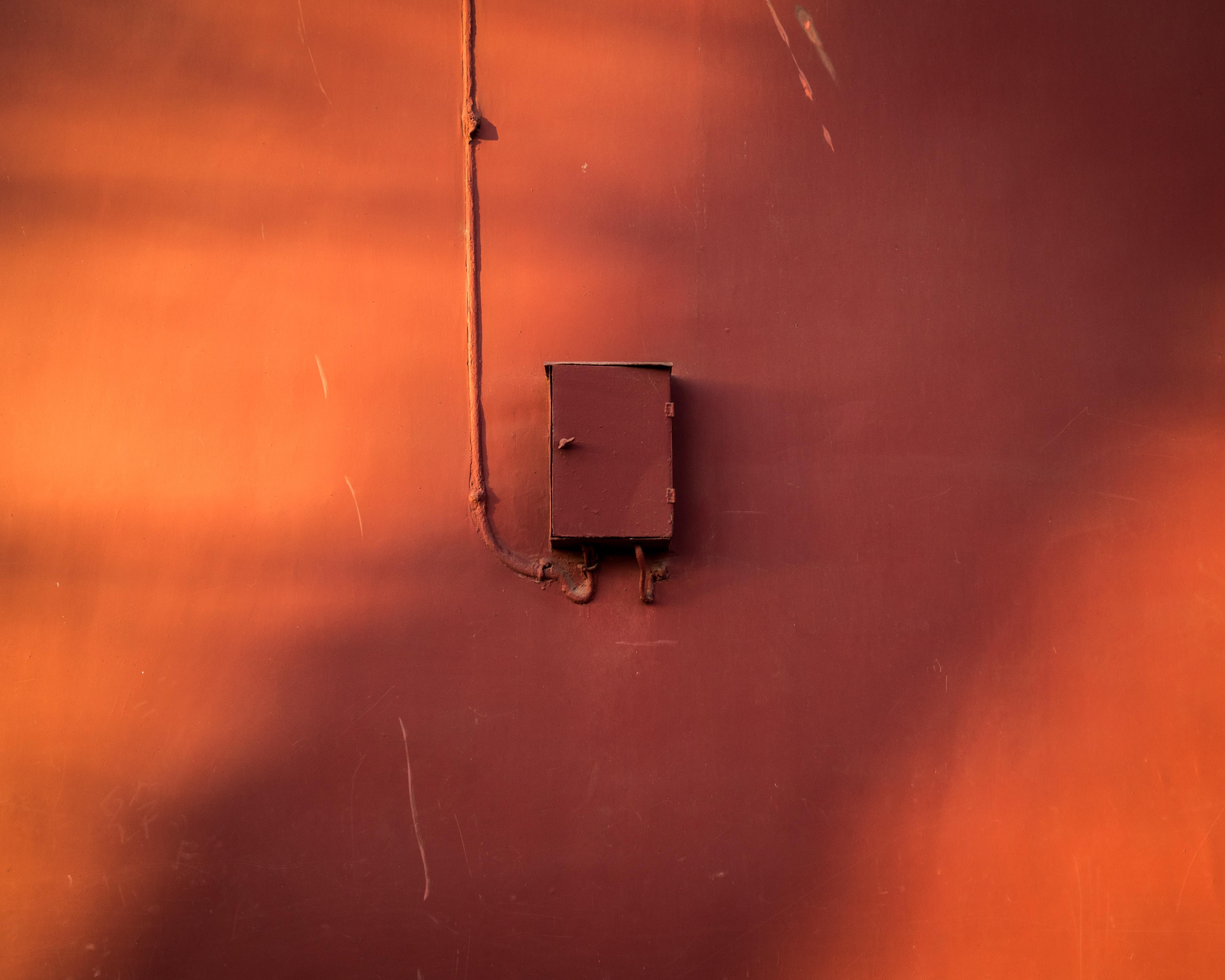 photo of brown power distribution box mountain on wall