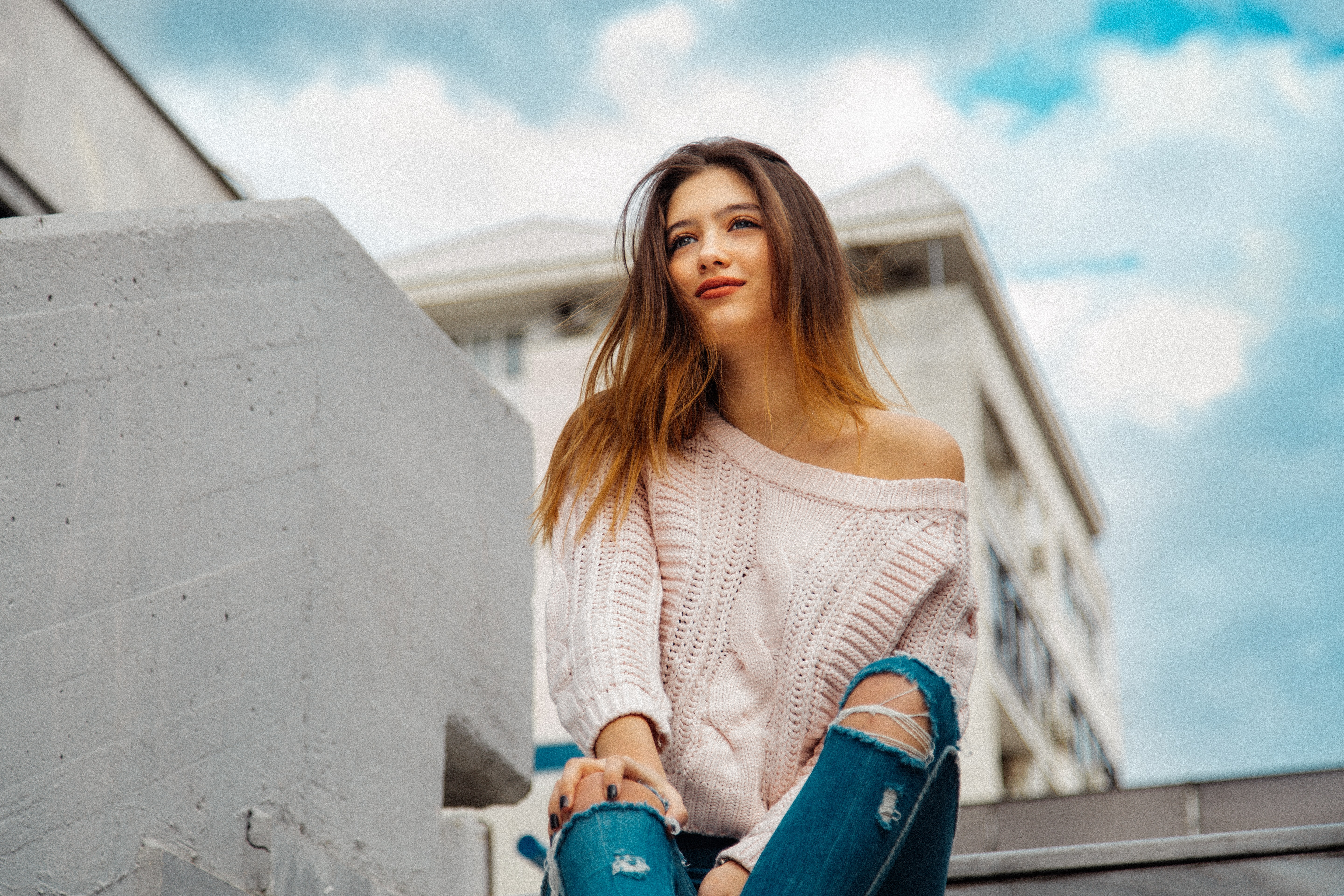 woman smiling and sitting on outdoor stair