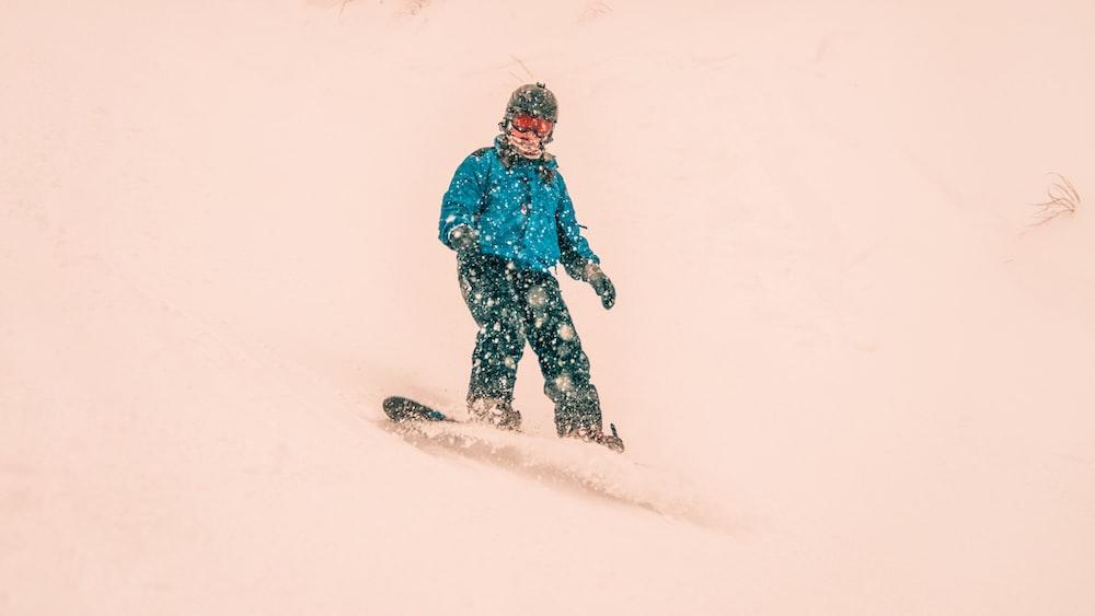 person using snowboard