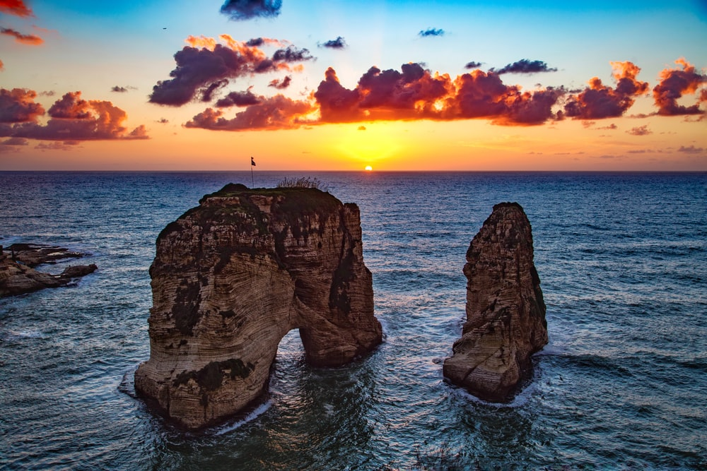 two rock formations in body of water
