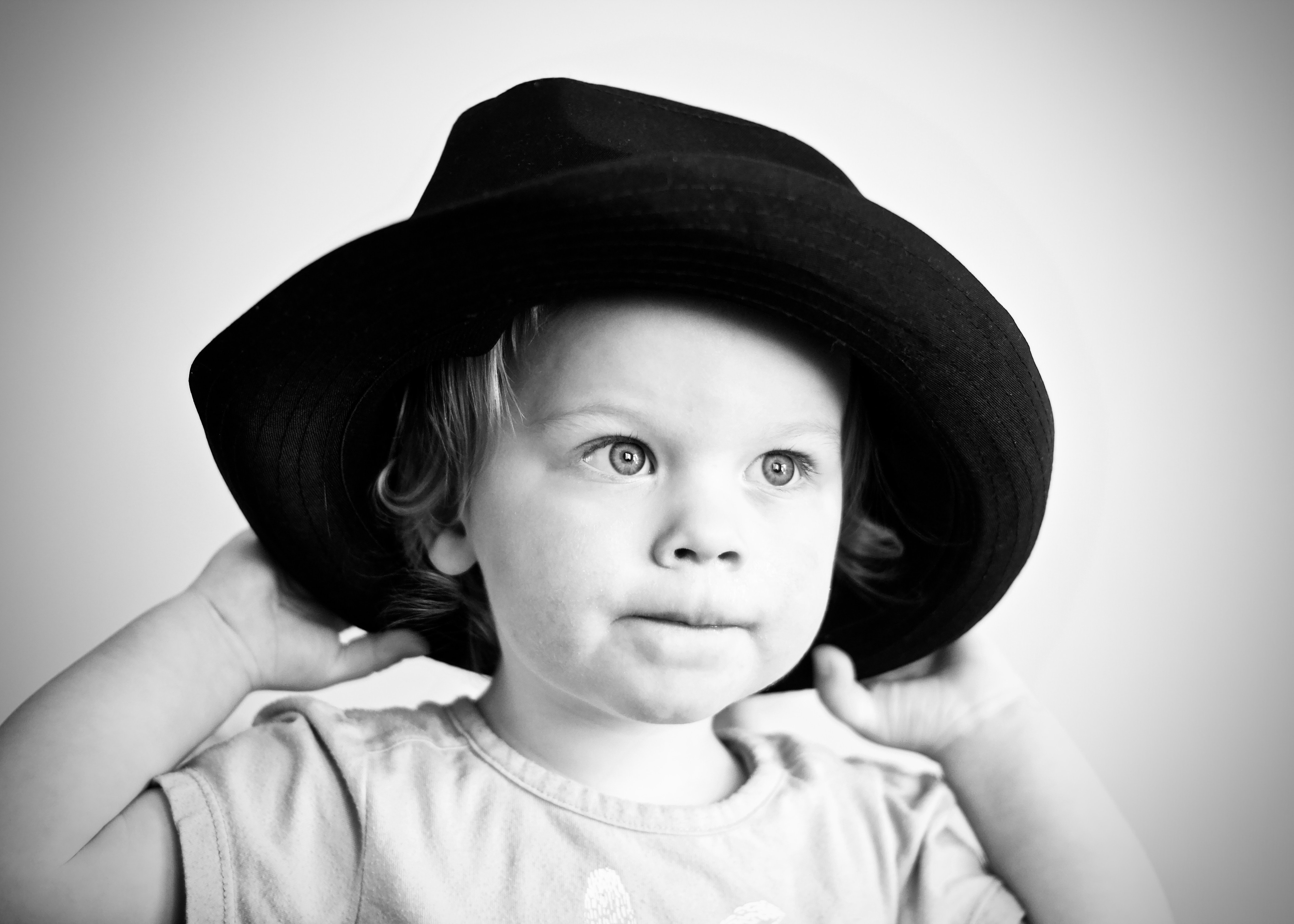 grayscale photography of girl with hat
