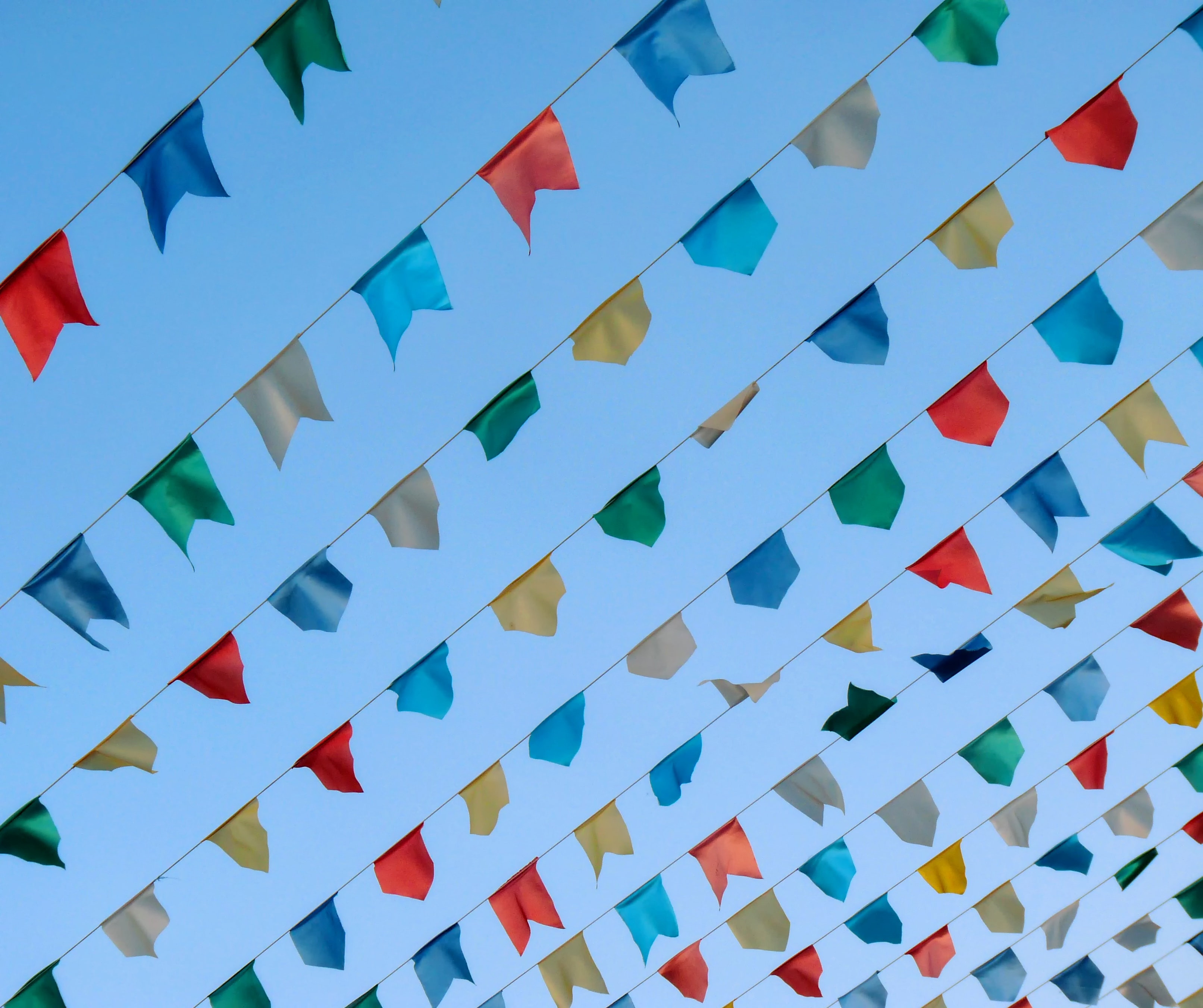 low-angle photography of assorted-color pennant banner lot