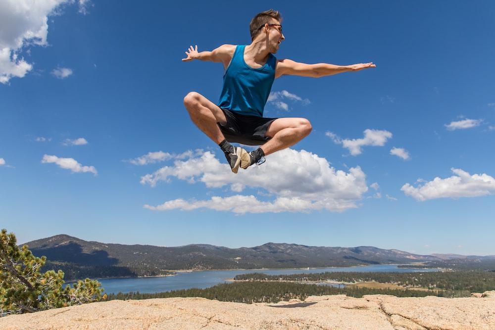 man doing jumpshot during daytime symbolizing high arousal