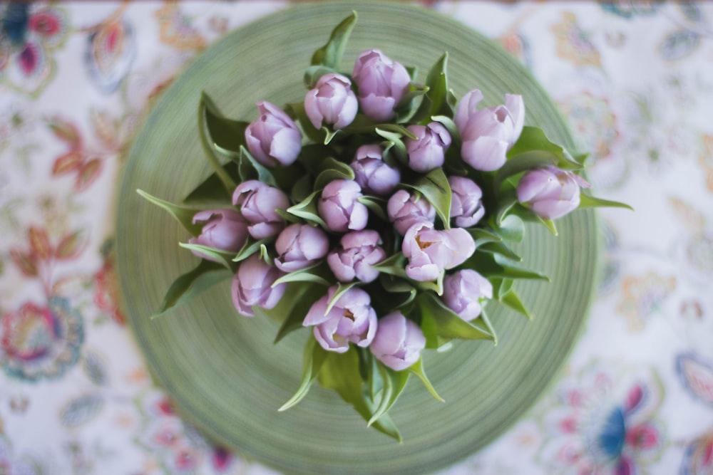 top view photo of purple petaled flowers in vase