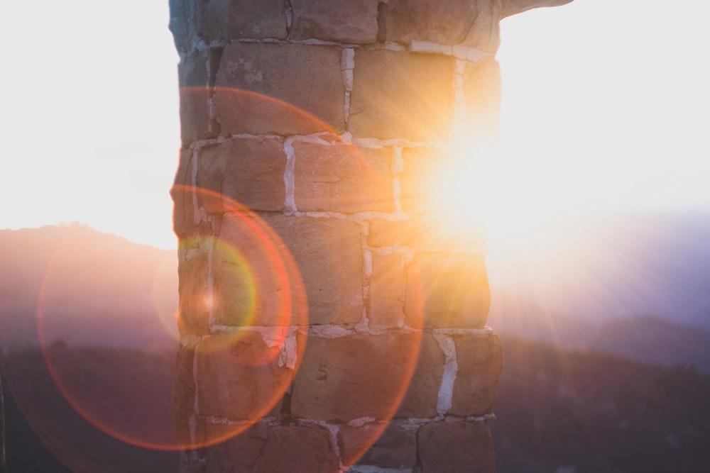 concrete bricked pillar with sunlight during daytime