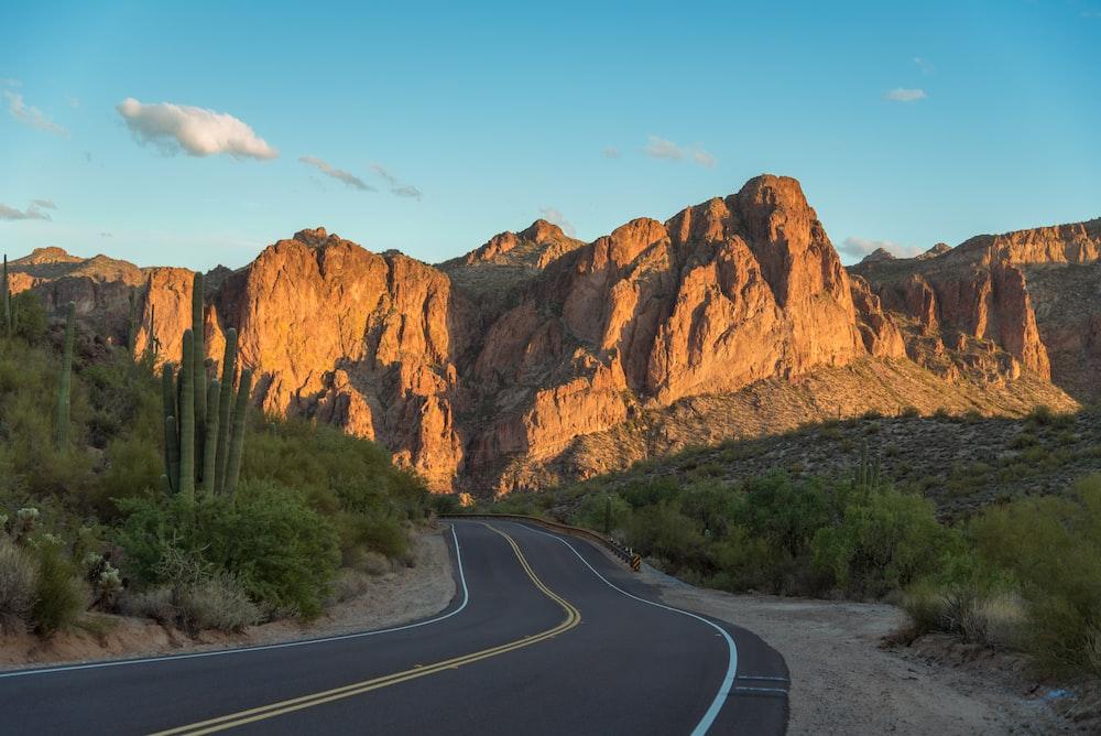 black asphalt road near mountain