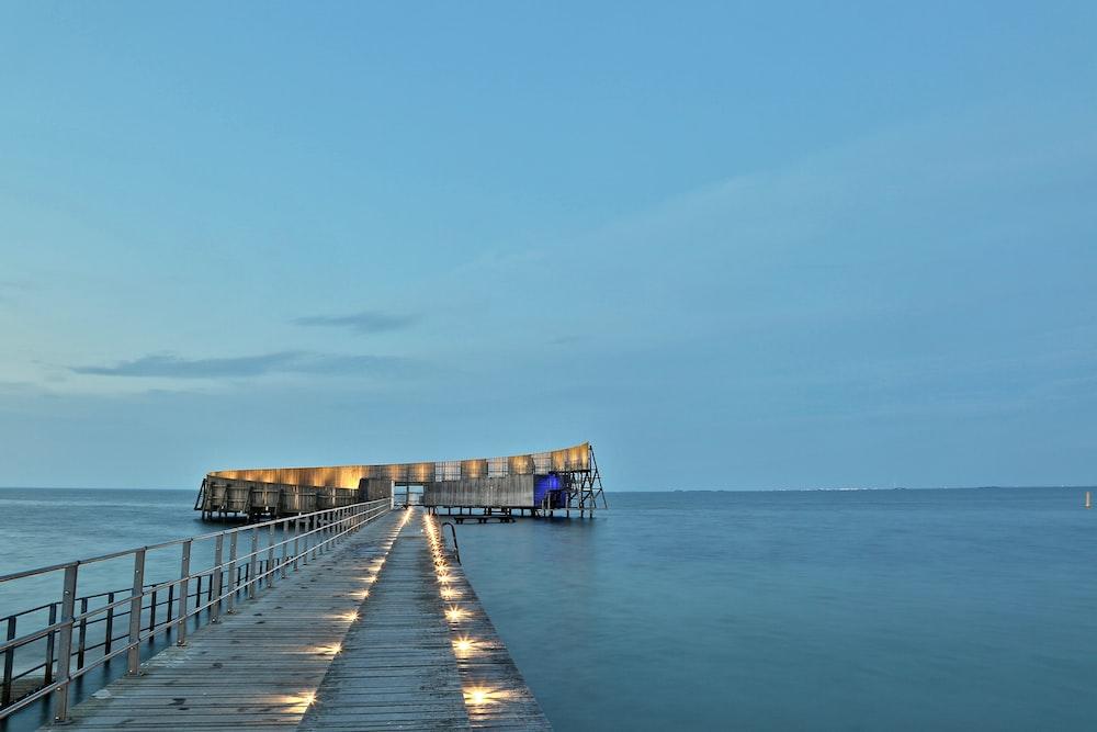 beach dock on beach under blue sky