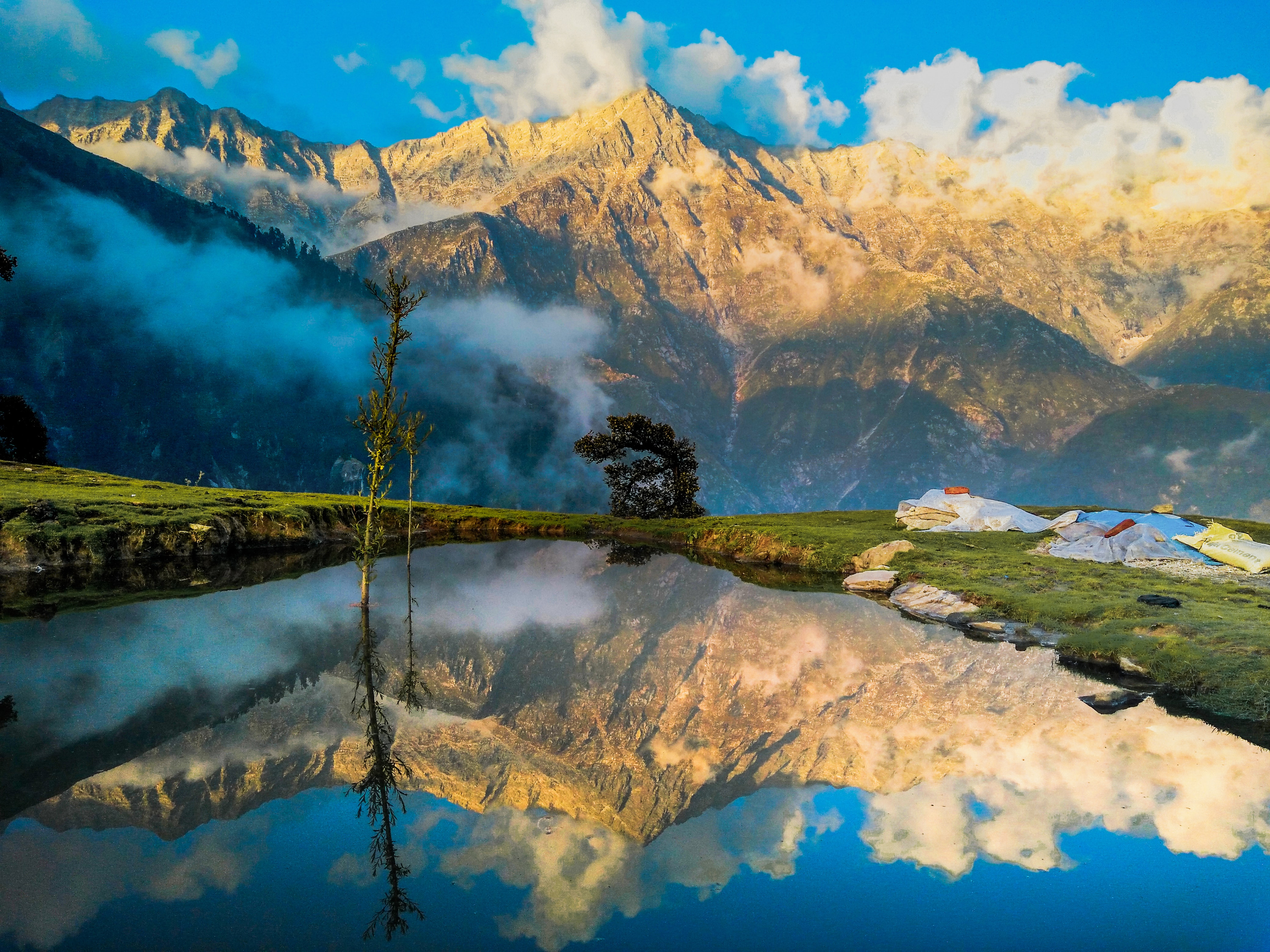 mountain reflecting on body of water