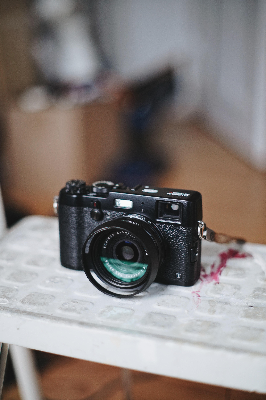 black camera on white plastic table