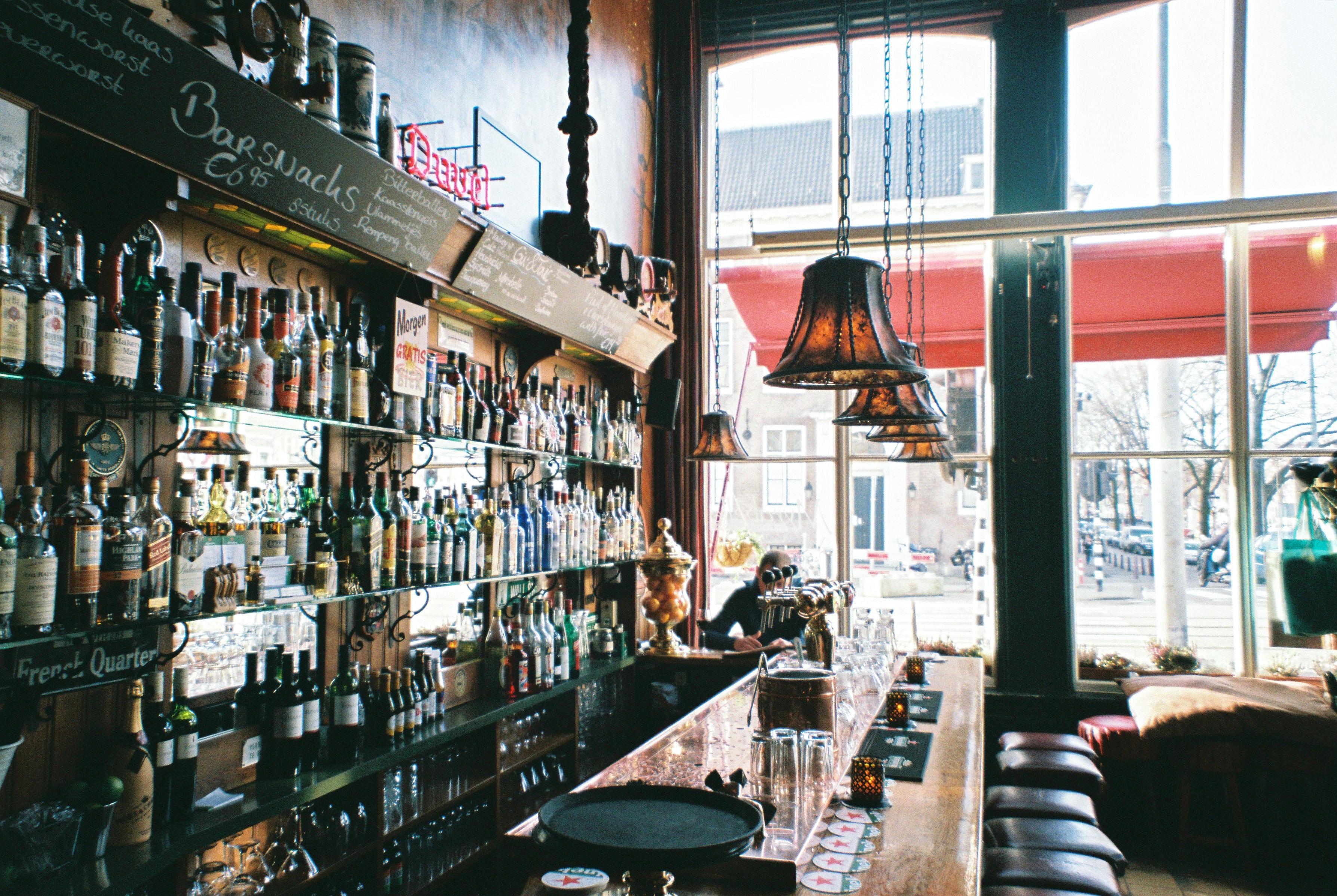 brown wooden bar table near window