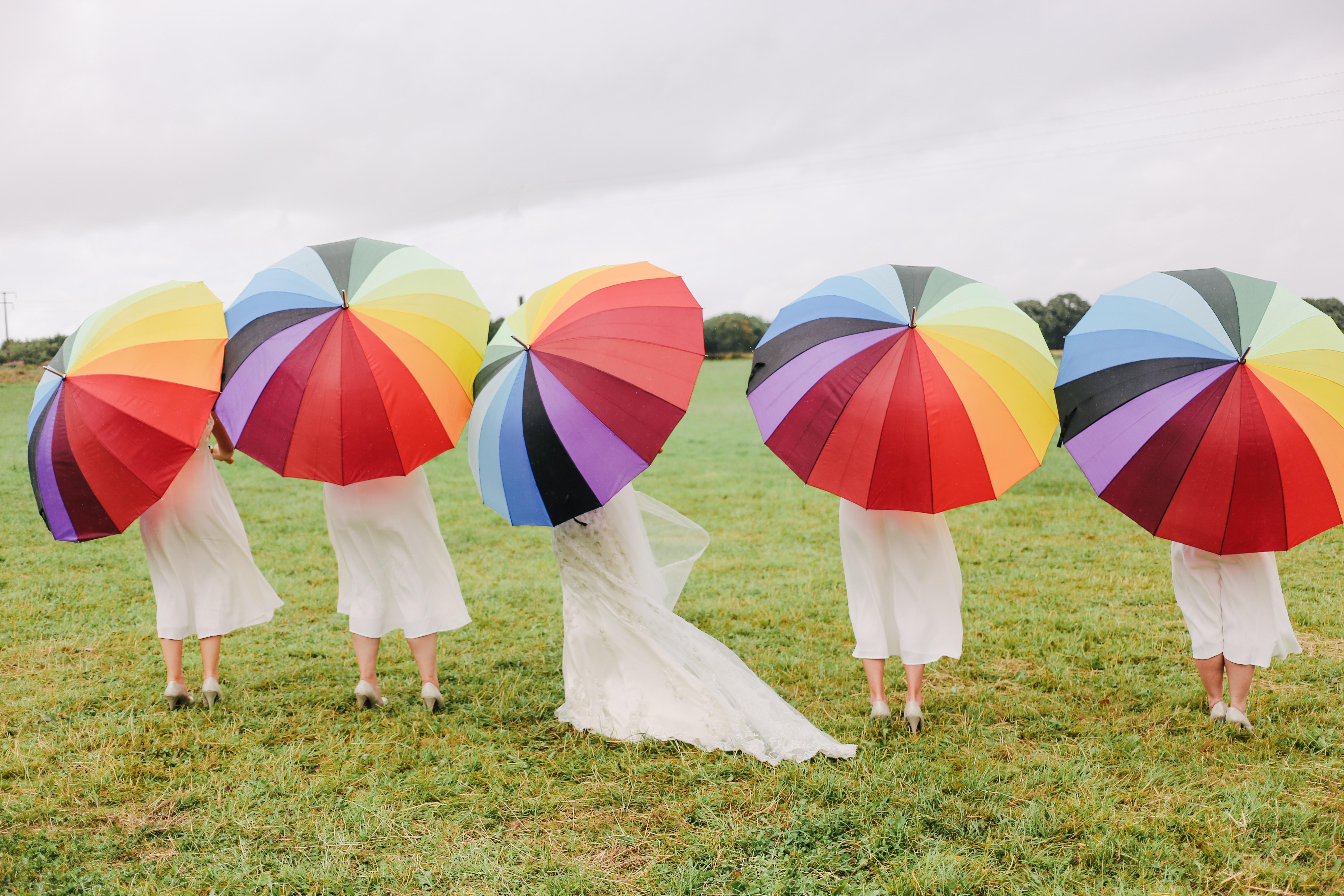 women under multicolored umbrellas