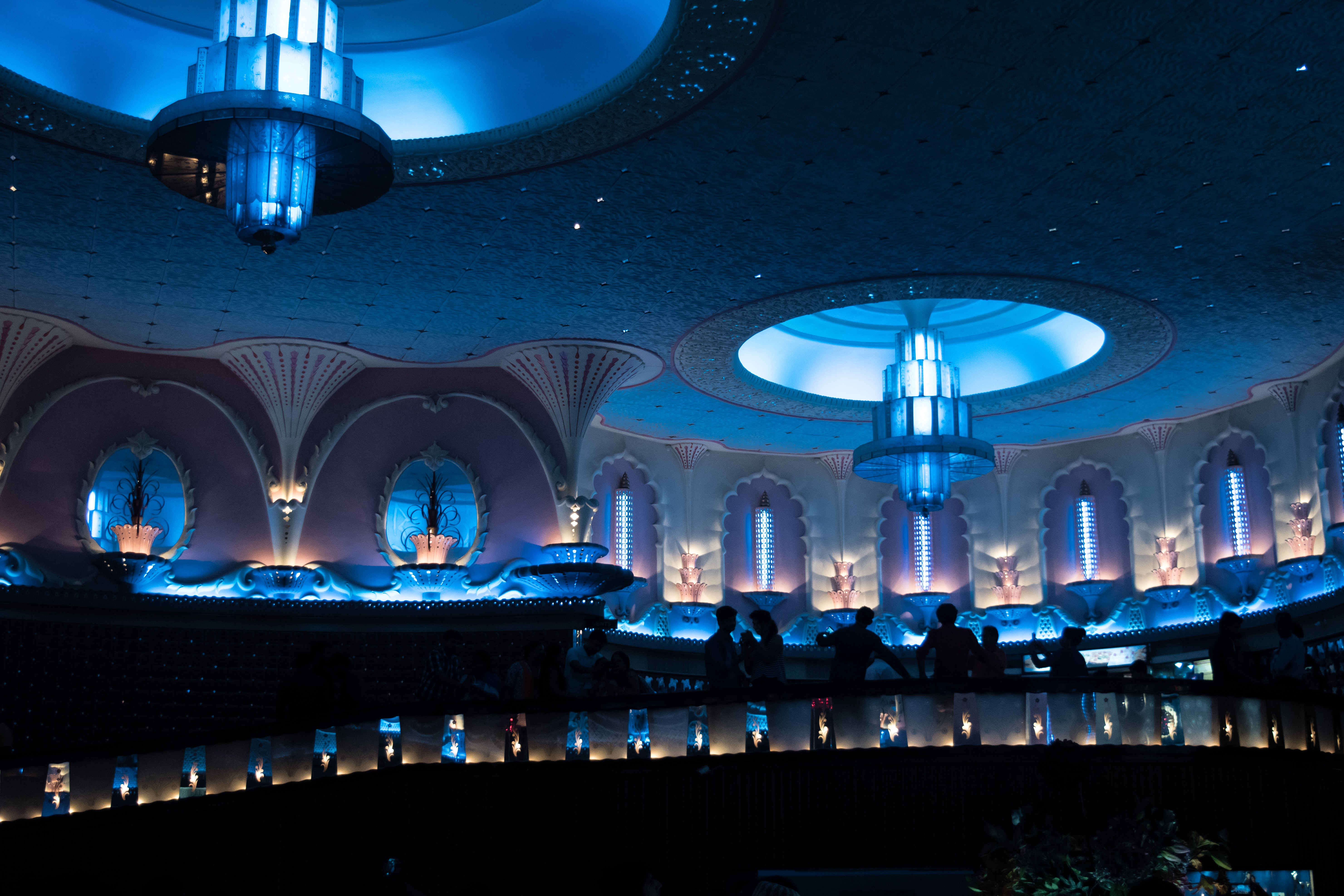 lighted hall with large light fixtures mounted on ceiling