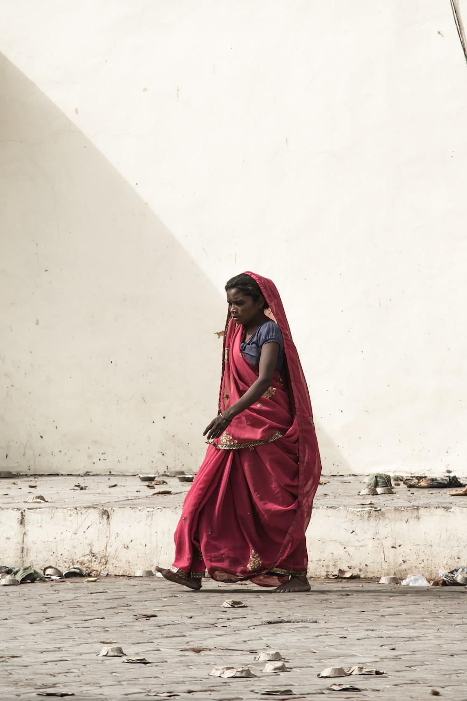 photo of woman walking on roadway