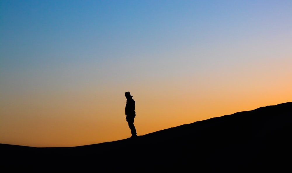 man's silhouette photo during golden hour